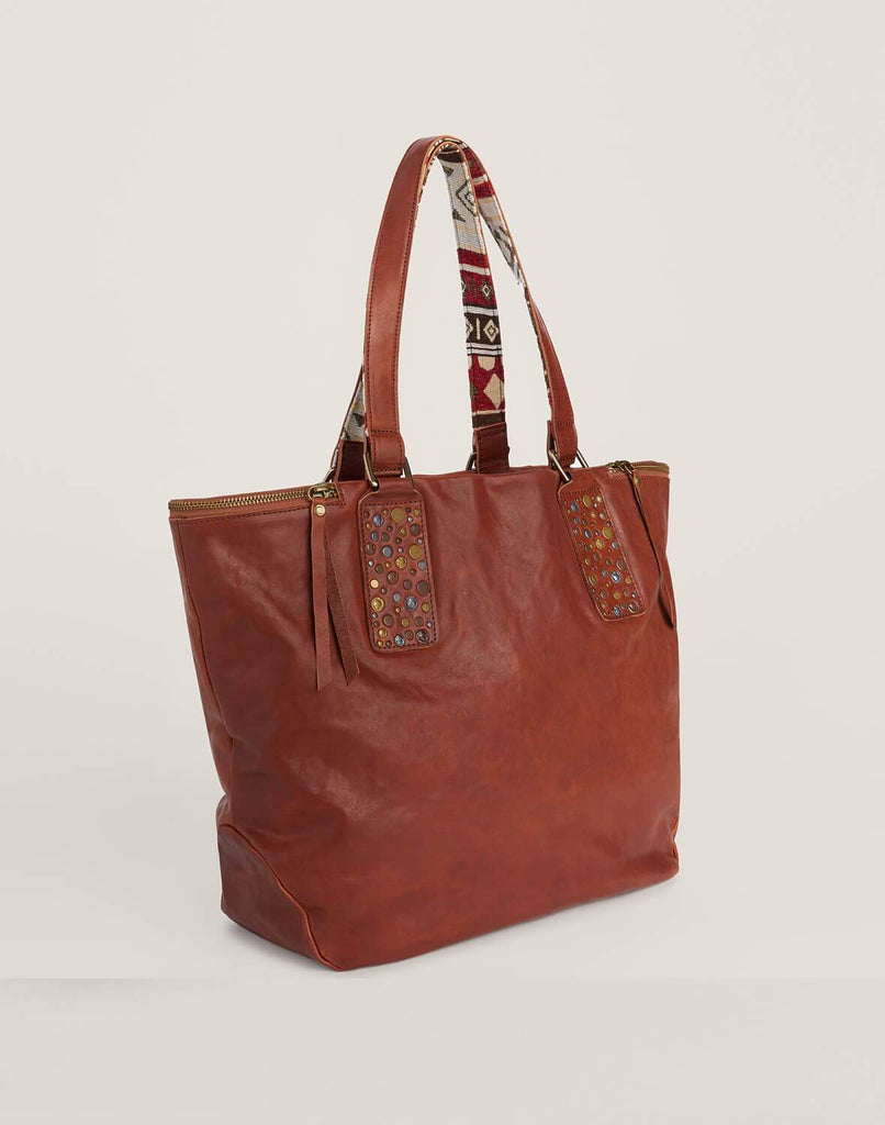 Side shot of Hammered Stud Tote in Cognac