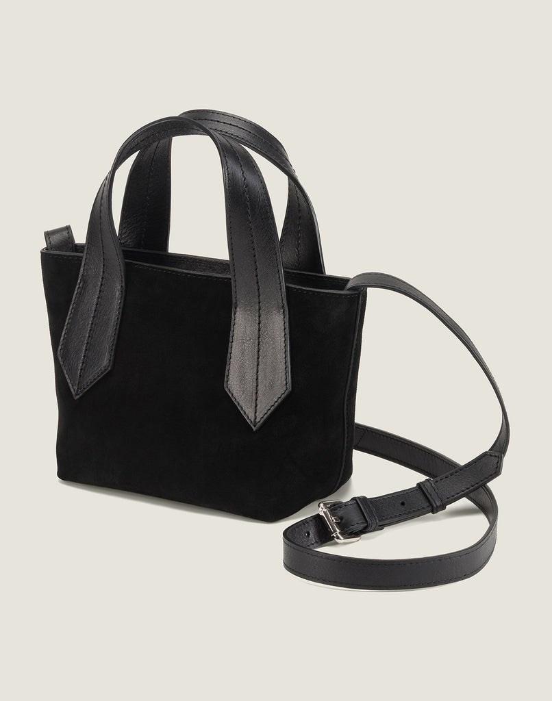 SIDE SHOT OF THE TAB TOTE MINI IN BLACK SUEDE AND CROSSBODY STRAP