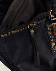 Zip detail shot of Hammered Stud Tote in Black
