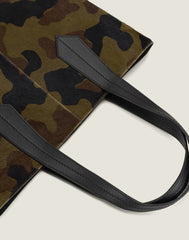 LEATHER HANDLE SHOT OF THE TAB TOTE IN CAMO HAIR CALF