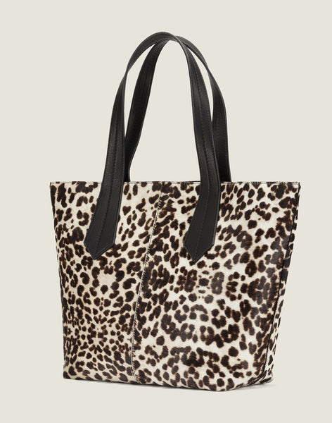 SIDE SHOT OF THE TAB TOTE IN SNOW LEOPARD