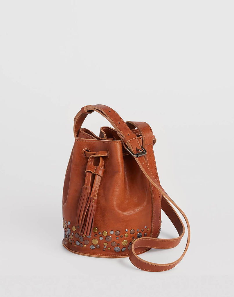 Side shot of Mini Hammered Stud Bucket Bag in Saddle