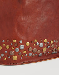 Detail of Stud on Hammered Stud Bucket Bag in Cognac