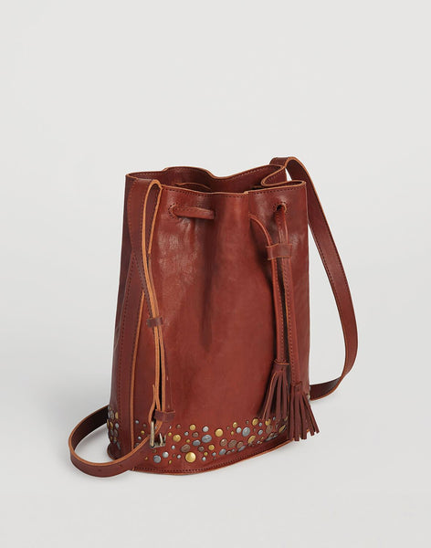 Side shot of Hammered Stud Bucket Bag in Cognac