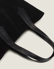 LEATHER HANDLE SHOT OF THE TAB TOTE IN BLACK SUEDE