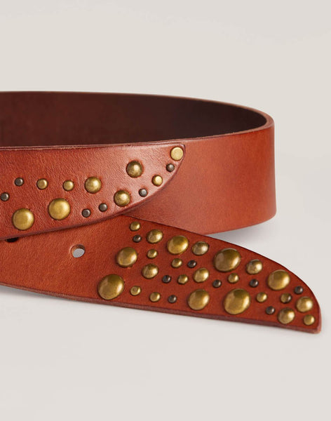 Stud detail shot of Showstopper belt in Cognac