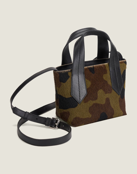 SIDE SHOT OF THE TAB TOTE MINI IN CAMO HAIR CALF AND LEATHER CROSSBODY STRAP