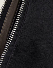 Zip detail shot of black Everyday crossbody