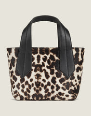 FRONT SHOT OF THE TAB TOTE MINI IN SNOW LEOPARD
