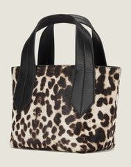 SIDE SHOT OF THE TAB TOTE MINI IN SNOW LEOPARD