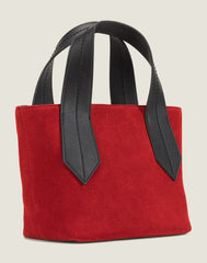 SIDE SHOT OF THE TAB TOTE MINI IN RED SUEDE