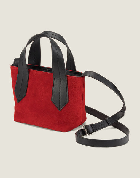 SIDE SHOT OF THE TAB TOTE MINI IN RED SUEDE AND LEATHER CROSSBODY STRAP
