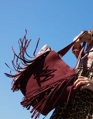 Alt shot of model wearing Cascade Fringe Tote in Burgundy