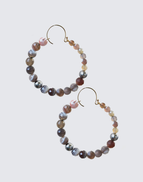 Flat lay of Natural Botswana Agate and Swarovski Pearl Hoop Earrings