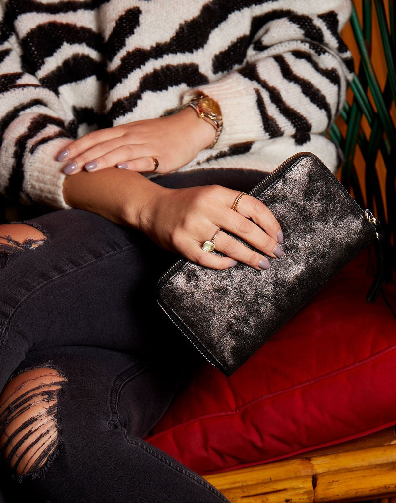Model with Metallic Clutcher Wallet in Black Metallic