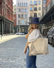 Model wearing Vanilla Fringe Tote