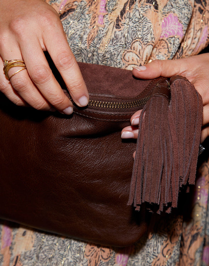 Detail shot of Convertible Fringe Belt Bag in Chocolate