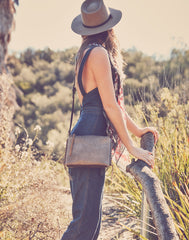 Model wearing One-of-a-Kind Low Back Denim Overalls, Hat Attack's Brady Hat and Everyday Crossbody in Natural