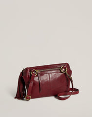 Back shot of Convertible Fringe Belt Bag in Burgundy