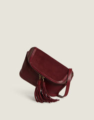 Front shot of Convertible Fringe Belt Bag in Burgundy