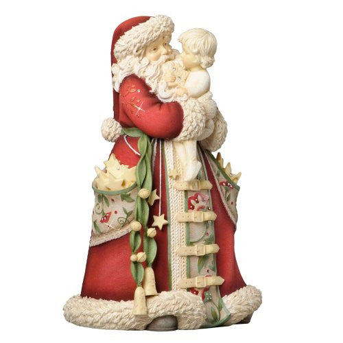 The Heart of Christmas Santa with Child Figurine