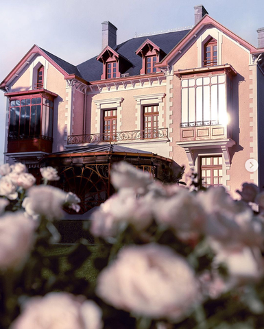 Dior's Normandy house with roses in the foreground