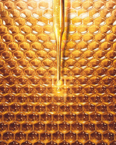 Golden honeycomb with skincare dropper