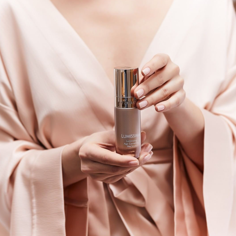 Dr Irena Eris Lumissima product shot held by woman in silk robe