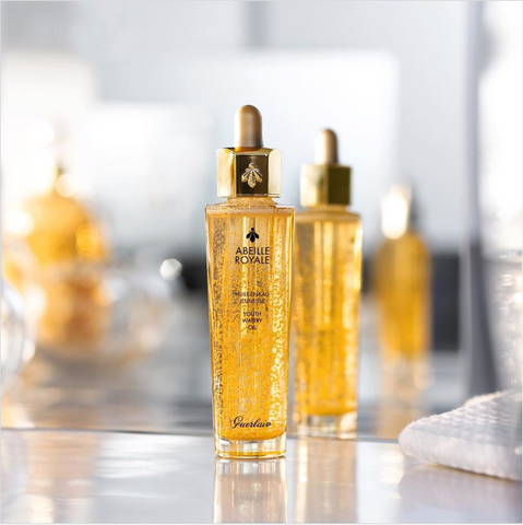 Guerlain Youth Watery Oil image against mirror