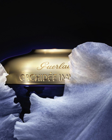 guerlain orchidee imperiale rich cream promotion image with white orchid petals