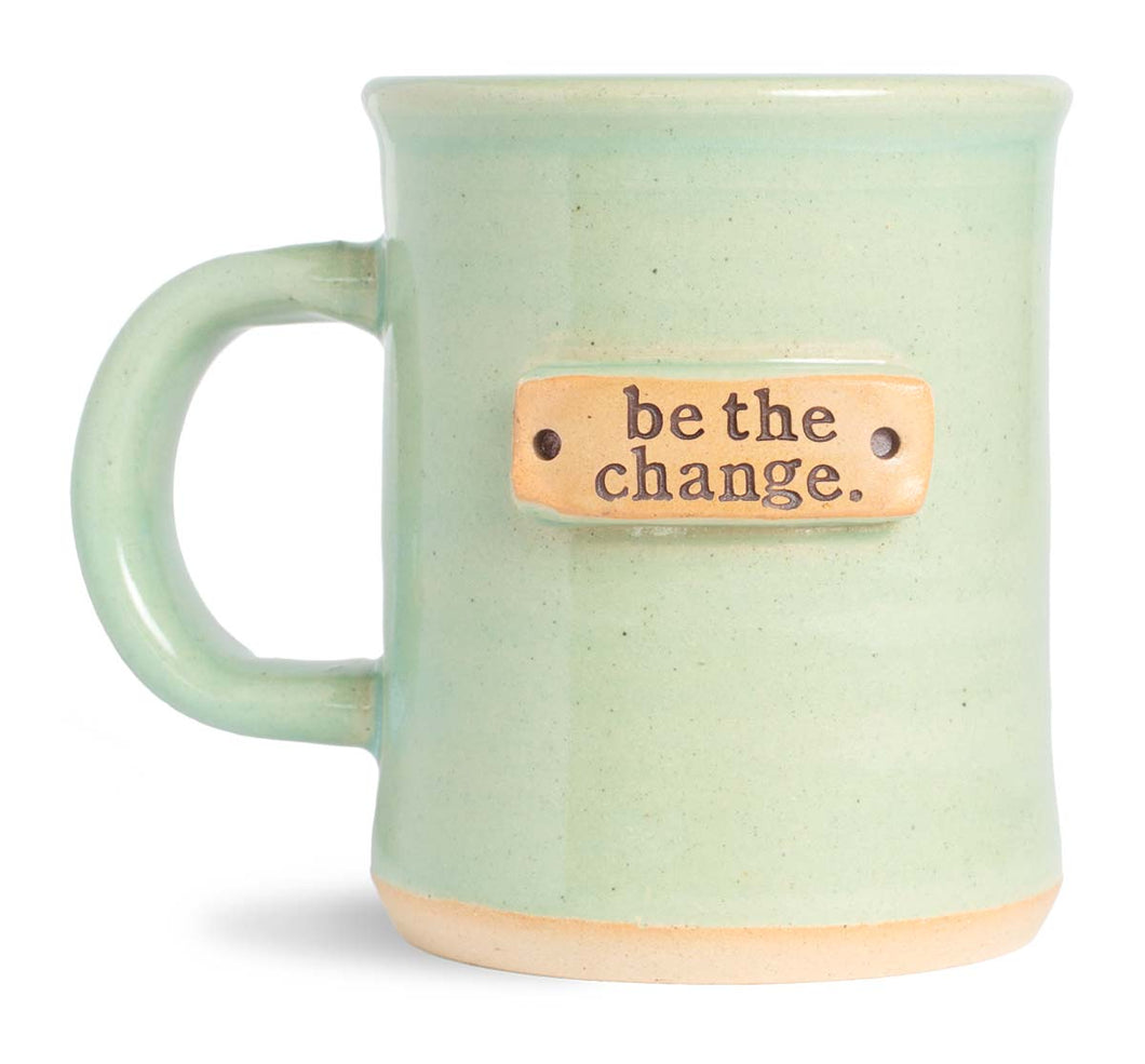 be the change. mug