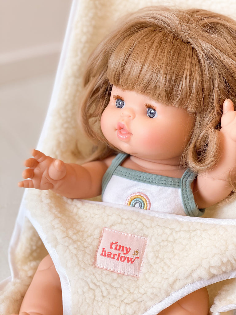 Doll sitting in Tiny Harlow Sherpa stroller
