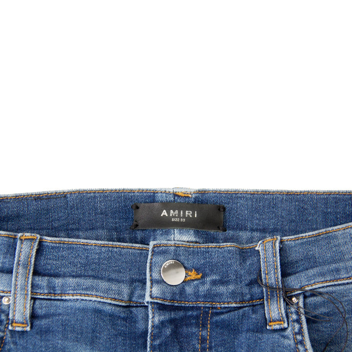 AMIRI DISTRESSED MX1 LEATHER PATCH MED INDIGO DENIM