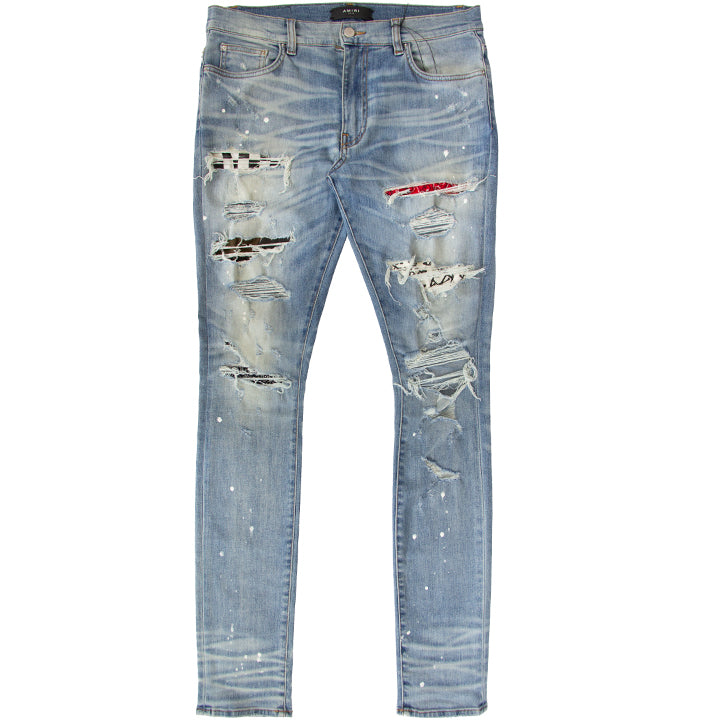 AMIRI DISTRESSED SKINNY ART PATCH PAINTED DENIM