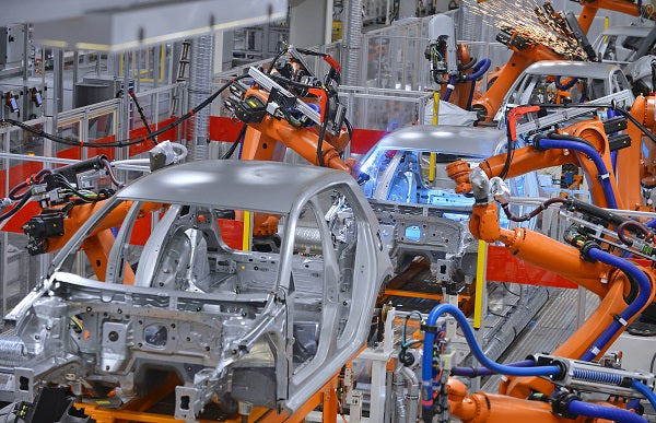 Image of a robotic arms in an automobile factory