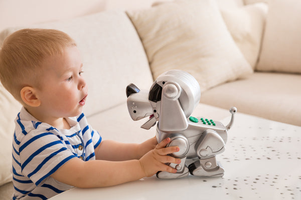 Photo of child with robot dog