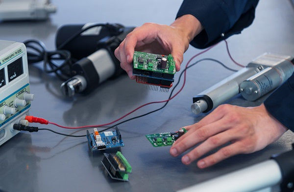 Using linear actuators with microcontrollers, and sensors
