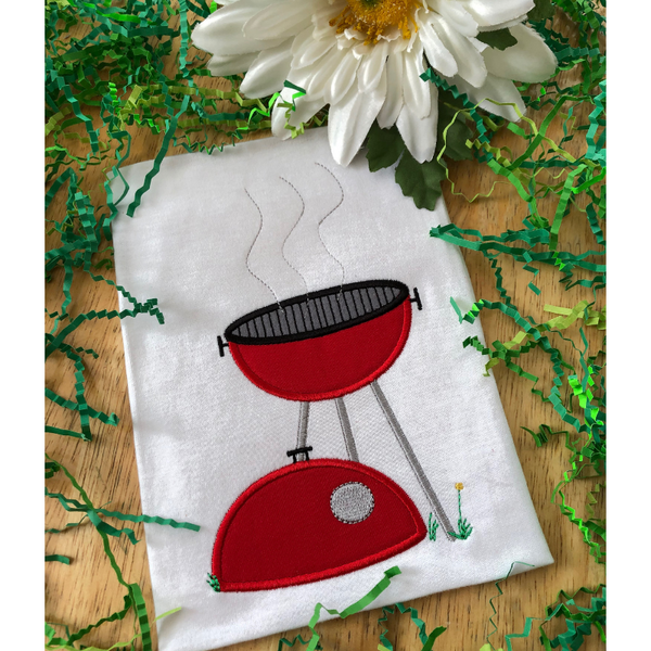 An applique of a BBQ grill with the lid on the ground and heat waves coming off the girll, grass and a dandelion  snugglepuppyapplique.com