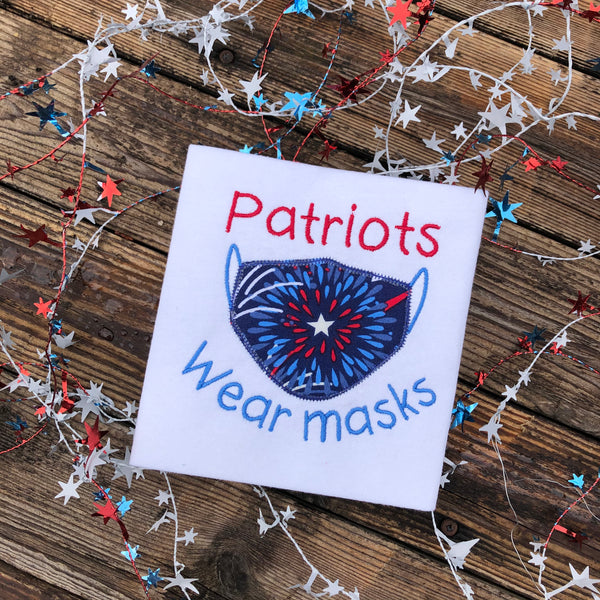 "An applique of a face mask with the words ""Patriots wear masks"" by snugglepuppyapplique.com"