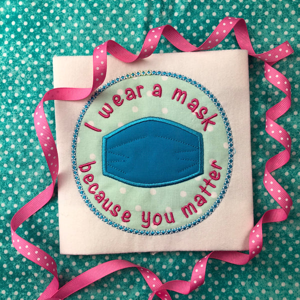 """I wear a mask because you matter"" surgical mask applique embroidery Design by snugglepuppyapplique.com"