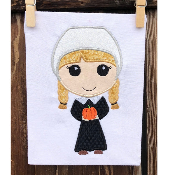 Pilgrim Girl applique embroidery design, stylized with large head holding a tiny pumpkin