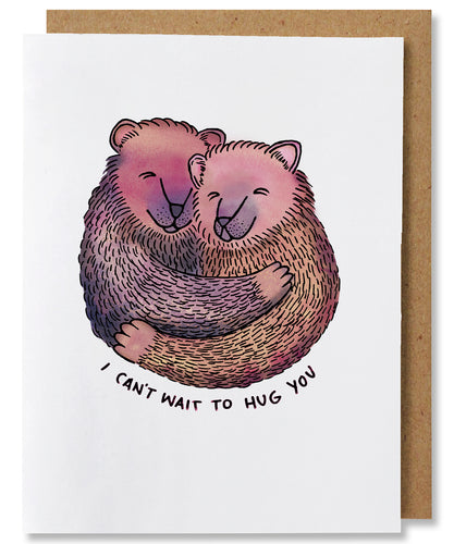 This greeting card features two embracing bears that are colored in shades of brown, pinks, yellows, and purples. The bears' bodies are shown from the waist up and from front view, their heads nestled close to each other and overall they are creating a circular shape.  The words