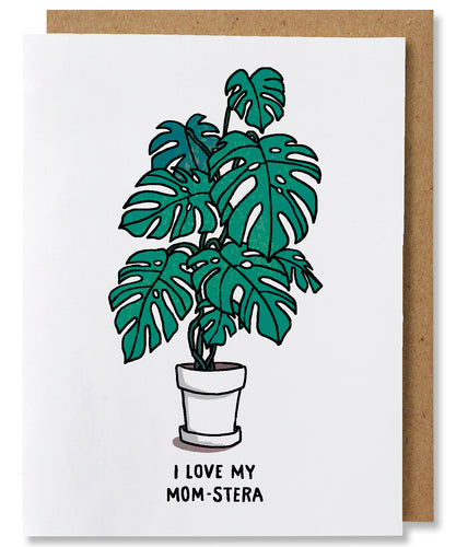 I Love My Mom-stera is a white ground greeting card that features a monstera deliciosa plant potted in a white planter. The words beneath say