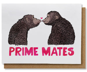 "This greeting card features two chimpanzees, in profile, facing and gazing at each other. They are posed to kiss and there is a tiny dark pink heart between them right above their about-to-touch lips. Underneath them, spanning the width of the card, in deep pink, are the words ""Prime Mates"". This card is paired with a brown kraft envelope."