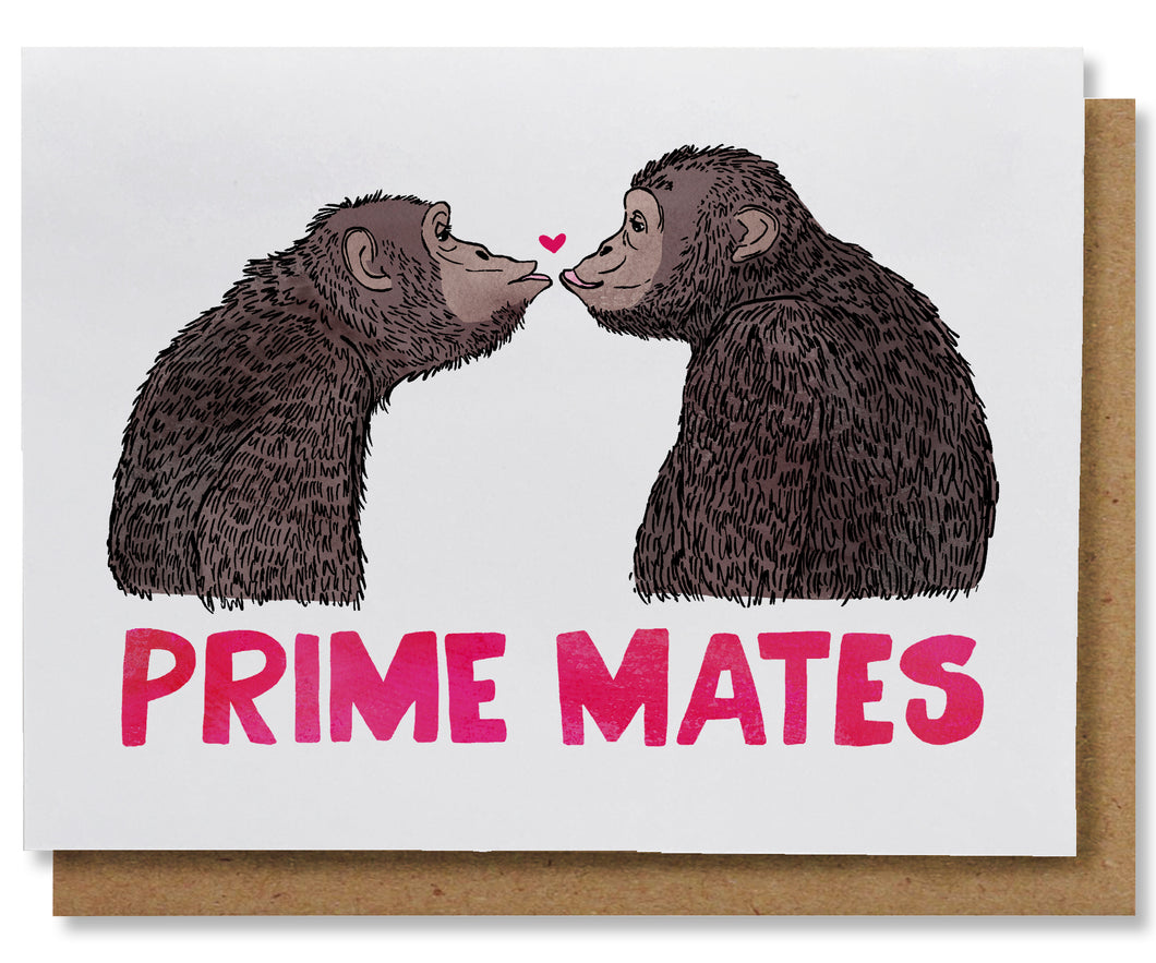 This greeting card features two chimpanzees, in profile, facing and gazing at each other. They are posed to kiss and there is a tiny dark pink heart between them right above their about-to-touch lips. Underneath them, spanning the width of the card, in deep pink, are the words