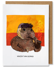 Load image into Gallery viewer, The Vincent van Gopher greeting card depicts Vincent van Gogh as a gopher. The gopher is facing the right, wearing a grey blue winter hat, and has a bandaged ear. He is holding a wooden smoking pipe in his left paw with hints of smoke coming up and holding a human ear in his right paw, a nod to van Gogh cutting off his ear. The background has two horizontal blocks of swirly colors, yellow on top of red. This card is placed with a brown kraft envelope.