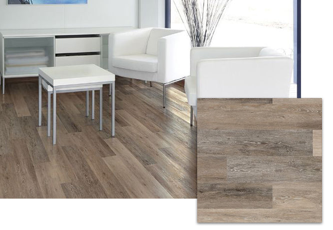 A living room showing COREtec Blackstone Oak vinyl flooring, available at Standard Paint & Flooring.