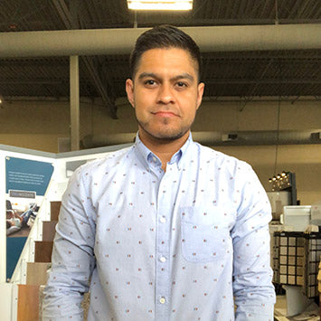 Carlos Alcaraz smiling at Standard Paint & Flooring's Richland, WA location.