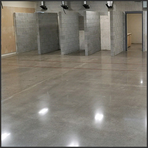 A beautiful concrete floor that has been finished by Standard Paint & Flooring in Washington State. Contact for concrete finishing services.