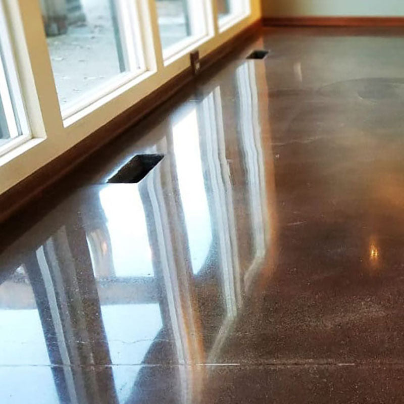 A concrete floor that has been polished by Standard Paint & Flooring.